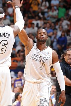 FEBRUARY 10: Dwyane Wade #3 of the Miami Heat and LeBron James #6 of the Miami Heat greet each other