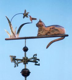 The Cat with Hummingbird Weather Vane can be customized upon ordering. This artisan piece is handmade of copper and brass with optional gold leafing.