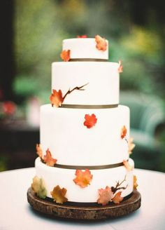 Fall Wedding Cakes: orange maple leave accent on the cake, a simple but classic wedding cake.