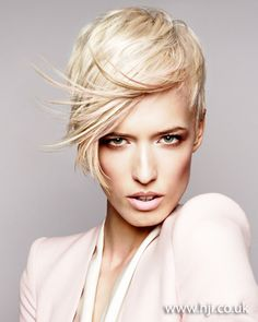 A layered blonde crop was prepped with texture spray and roughly blow-dried, scrunching through by hand to add movement and define the layers. Oce dry, more texture spray was added and scrunched through.