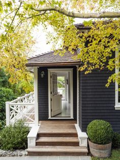 Mill Valley House Tour + Black Exterior + Foliage + white window trim against black siding + landscaping design + custom white railing on the wrap around porch Design Exterior, Black Exterior, Little Cottages, Plein Air, Black House, Cottage Style, House Colors, Curb Appeal, Beautiful Homes