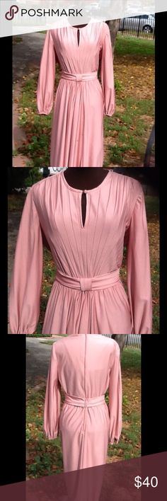 Beautiful, soft Rose pleaded  dress Beautiful rose VTG dress scoop neck with French covered button. Pleated front shoulders, and seem stitching  in a v form stunning 2 inch attached waistband that hooks in the back . Bust 42waist 32 hips 42 flairs  even more. Vintage Dresses Midi