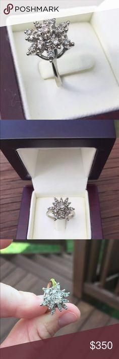 14K White Gold Diamond Cluster Ring $1012 I purchased this ring at a high end jewelry store a few years back and it has sat in the box. I just had this beautiful piece appraised and will include the appraisal for your records. Valued at $1,012.00 One 2.5mm center stone surrounded by twelve 1.5mm side stones.  .25ct total weight. Please see photo of appraisal for more details.  This is a stunning ring. Comes with a box. Would make a beautiful gift. Jewelry Rings