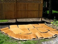 """""""Use cardboard to line new garden bed instead of landscaping fabric. Wet newspaper layers work well, too.""""  I used this method for adding on to my veggie garden."""