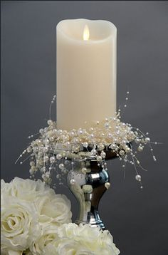Luminara flame-effect pillar with pearl spray candle ring would be beautiful for my wedding and bridal showers