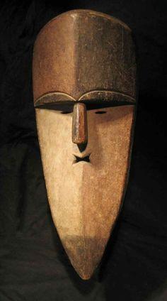 Antique Aduma mask from Gabon, Africa.