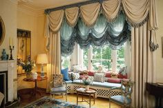 """The elaborately dressed bay window in the drawing room, with swag and tail curtains and festoon blinds.  Like this? Then you'll love  [link url=""""http://www.houseandgarden.co.uk/interiors/curtain-design-ideas""""]Curtain Call[/link]"""