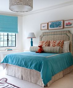 Turquoise, coral, and tan make for an energizing, but not overwhelming color scheme.