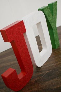 Paper Mache letters painted and glittered.