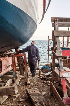Trikeri. TA Boatyard on the tip of the Pelion. After work its owner takes a long look at the sea. © Benjamin Tafel.