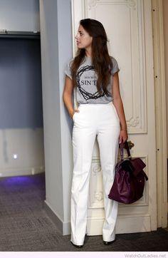 White pants, grey tee and purple bag
