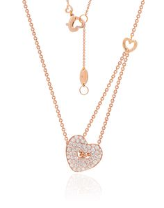 Chain my heart by Stenzhorn. Heart shape shirt button pendant in rose gold and white diamonds