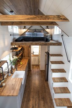 Our standard Farmhouse model has all of the details that you would expect from us! We include pipe shelving & railing, a farmhouse sink, painted ship lap, and wood accents throughout. Tiny House Loft, Small Tiny House, Best Tiny House, Modern Tiny House, Tiny House Living, Tiny House Plans, Small House Design, Tiny House On Wheels, Inside Tiny Houses