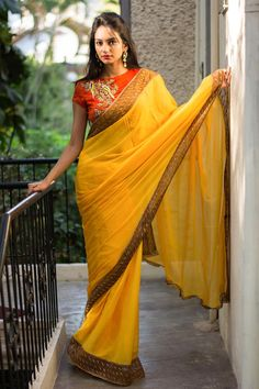 Chiffon LOVE pouring your way! Two thumbs up to another stunningly combined chiffon saree. This time in a beautiful shade of mustard yellow bordered in an orange cutwork on gold shimmer. Just the freshest combination detailed with love.A gold blouse or a yellow blouse to bring sunshine to any do! Or do as we do and glam things up with a rich looking orange blouse with zardosi detailing. #houseofblouse #saree #blouse #indianwear #india #fashion #bollywood #mustard #yellow #cutwork #chiffon