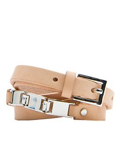 Slim leather belt with decorative metallic details and a buckle closure
