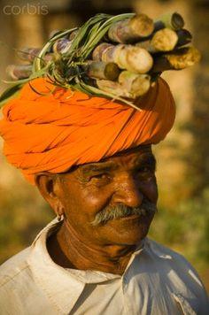 Orange Turban and Sugarcane