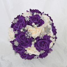 Cadbury's purple and Ivory silk roses and crystal snowflakes.