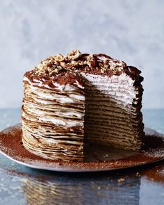 Tiramisu meets crepe in this decadent, yet surprisingly easy, layer cake. Serve at a dinner party with lashings of cream and you& bound to impress your guests. Just Desserts, Delicious Desserts, Dessert Recipes, Yummy Food, Crepe Delicious, Tiramisu Crepe Cake Recipe, Tiramisu Cake, Tortas Deli, Pannekoeken Recipe