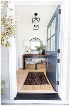 Love this beautiful entryway with a blue Dutch door, rustic wood console table, and round mirror Modern Entryway, Entryway Ideas, Entryway Decor, Beautiful Interior Design, Interior Design Inspiration, Home Decor Styles, Home Decor Accessories, Entryway Furniture, Decorating Coffee Tables