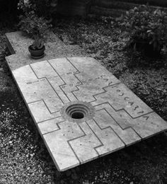 Grave of Carlo Scarpa, architect (1906 - 1978). Scarpa designed the entire cemetery he was buried in. Scarpa was commissioned by the Brion family to design an addition to the preexisting cemetery. In classic Scarpa style, he created a monumental tomb with immaculate architectural detail. Scarpa must have loved his end product so much, that he was buried there himself. Via the Commune Daily blog.