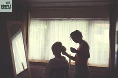 Atmospheric, moody photo of the bride as she's getting her hair & make-up done. Weddings at The Johnstown Estate, photographed by Couple Photography.