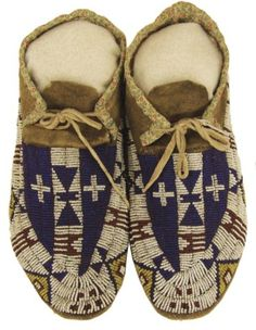 """Arapaho Beaded Moccasins   Exceptional pair of sinew sewn and lazy stitch beaded elk hide moccasins with hard buffalo rawhide soles and rare crosses in the design. Very good condition, beautiful visual appeal. Circa: Early 1900s Size: 10"""" Sold for $ l,600.00"""