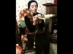 Spinning wool in Italy with spindle and hand distaff.  This is the best spinning video EVER.