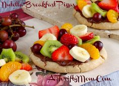 Store bought wheat dough and yummy Nutella spread topped with lots of  fresh fruit (strawberries, banana, kiwi, etc.) - this makes for an easy kid-friendly breakfast recipe that tastes, oh so good!    Recipe @:  http://athriftymom.com/nutella-breakfast-pizzas-kid-friendly-recipe/