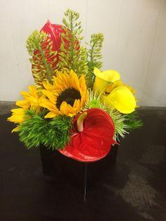 18MT Green Tricks, Sunflower, Red Anthurium, Yellow Calla Lillies