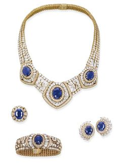 A IMPORTANT SAPPHIRE AND DIAMOND SUITE, BY CARTIER   The necklace designed as three oval-shaped sapphires within a brilliant-cut and pear-shaped diamond openwork surround to the similarly designed spacers, sides and back, bracelet, ear clips and ring en suite, necklace 39.0 cm long, bracelet 16.0 cm long, ear clips 3.0 cm long, ring size 5¾, with French assay mark for gold