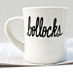 Hand painted diner mug with bollocks in black. Bollocks. Sounds so innocent. And in America it really is. Im not sure most of us even know what a