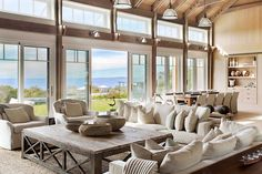 Ever dream of a summer beach house like the Hamptons? If yes, then you'd like this Menemsha beach barn house designed by Hutker Architects. You'd be in awe looking at the exteriors and interiors of Style At Home, Oak Coffee Table, Architectural Digest, Home Fashion, Open Plan, Great Rooms, House Tours, Living Room Decor, Dining Room