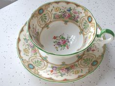 antique Aynsley tea cup and saucer set, 1930's English bone china. Hand painted