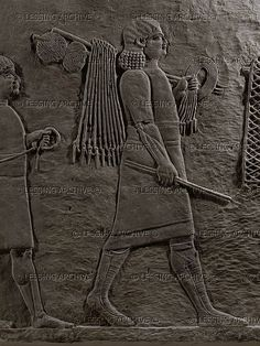 ASSUR RELIEF 10TH-6TH BCE Servants carrying hunting gear. Stone bas-relief (7th BCE) from the palace of Ashurbanipal in Niniveh, Mesopotamia (Iraq). British Museum, London, Great Britain