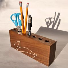 Organizer, can even use a 4x4 block of wood and drill some holes in it to make a desk/pen organizer.