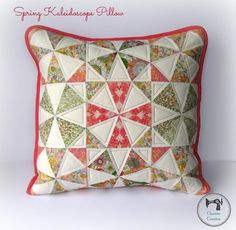 Craftsy member Charise Creates sewed a beautiful kaleidoscope pillow from Liberty fabric using this pattern, and the alternating white triangles really pop and make almost a floral motif. #MidnightQuiltShow