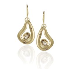 Teardrop-shaped 18k yellow gold Larme earrings, from the Gemmes des Formes collection, are satin-finished and feature cognac-colored diamond centers and full-cut brilliant, gypsy-set white diamond accents. #coloreddiamonds #yellowgold #lisadescampsjewelry
