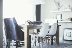 eames chairs for the dining room. love the wood + metal legs on these particular ones.