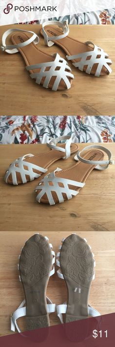 White Strappy Sandals These sandals have a closed-toe front, strappy faux leather upper, easy slip on/off construction, and buckle heel closure. Great condition minus a small defect on a white strap - left shoe (as pictured in 4th photo). Great to wear for spring and summer! Shoes Sandals