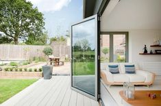 How to: Modernise a bungalow | homify | homify Bifold Doors Onto Patio, Fresco, Indoor Outdoor Living, Outdoor Decor, Outdoor Ideas, Modern Conservatory, Bungalow Extensions, Aluminium Cladding, Decking Area