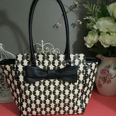 SUPER SALE TODAYBetsey Johnson blacK bone bow tote Very rare betsey johnson black and bone bow tote. It is in great condition with only the bottom corners having some sign on wear shown in the picture. Not very noticable. Zip closure with zip pocket inside. Longer shoulder straps. No Holds  no trades  Please use offer button to discuss price Betsey Johnson Bags Shoulder Bags