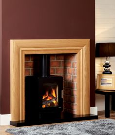 The Baltimore, with its striking simplicity, transforms a stark opening into a stylish fireplace while still maintaining a minimalist ambiance. Focus Fireplaces, Fire Surround, Log Burner, Gas And Electric, Electric Fireplace, Wood Ideas, Your Perfect, Baltimore, Beams