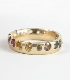 BY: POLLY WALES  Medium Band - multi color sapphires, yellow gold, A rainbow of sapphires set gorgeously higgeldy-piggeldy in 18k gold.