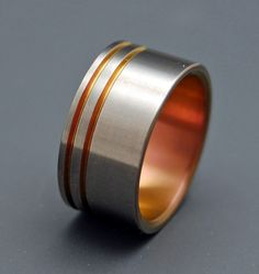 Light up your love. From burnt orange to bronze and pink, we carefully hand-anodize this band to achieve a color that mimic's nature's most romantic moment. A mirror finish interior and satin finish e