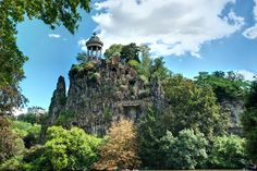 Parc des Buttes-Chaumont One of the most beautiful and serene parks in Paris, the Parc des Buttes-Chaumont sits in the north of the city. Venture down to the foot of the waterfall here where you'll find a very cool little grotto. It's more hilly and lush than the gardens in the center of town, which means it has a vantage point for great views of the capital. Plus, it's home to Rosa Bonheur—the ultra-hip watering hole where trendy young Parisians come to sip rosé en grande quantité.