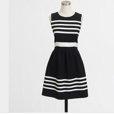 Awesome J Crew Black White striped dress Large So cute. Great solo or with a blazer. Woman's size large. Machine-washable. Minimal fade from normal wash wear. Sold out!! J. Crew Dresses