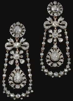 Pair of diamond pendent earrings, circa 1800. Each of stylised foliate and ribbon design, suspending a chain of rose diamonds in cut down collets and closed back settings, embellished with a swing set to the centre with a pear-shaped rose stone within surrounds of rose diamonds. Sotheby's.