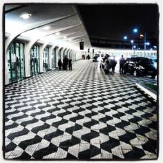 The lovely sidewalk tiles of the arrivals area of Congonhas Airport CGH in the shape of São Paulo State map. São Paulo, Brazil.