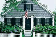Pretty hydrangea, fence and flag = New England charm