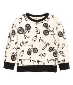 Check this out! Top in printed sweatshirt fabric with a scuba feel, with long sleeves and ribbing at the cuffs and hem. Soft brushed inside. - Visit hm.com to see more.